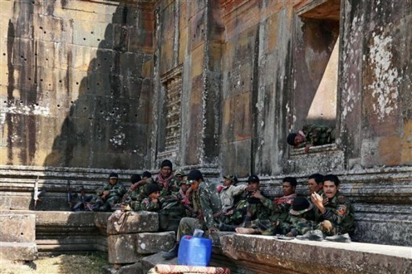 In this photo released by China's Xinhua News Agency, Cambodian soldiers rest at the Preah Vihear temple in Preah Vihear province, some 500 kilometers (300 miles) northwest of Phnom Penh, Cambodia, on Saturday, Feb. 5, 2011. A shaky cease-fire reached Saturday after the fiercest border clashes in y