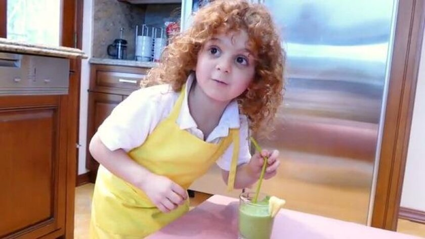 Benjamin Itkin samples a green smoothie, in the introductory video for Mi Kids