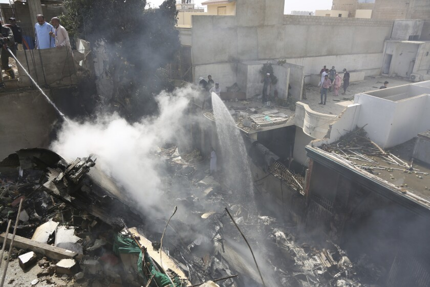 Firefighters in Karachi respond to the deadly crash of a passenger plane May 22. The aircraft was arriving from the eastern city of Lahore.