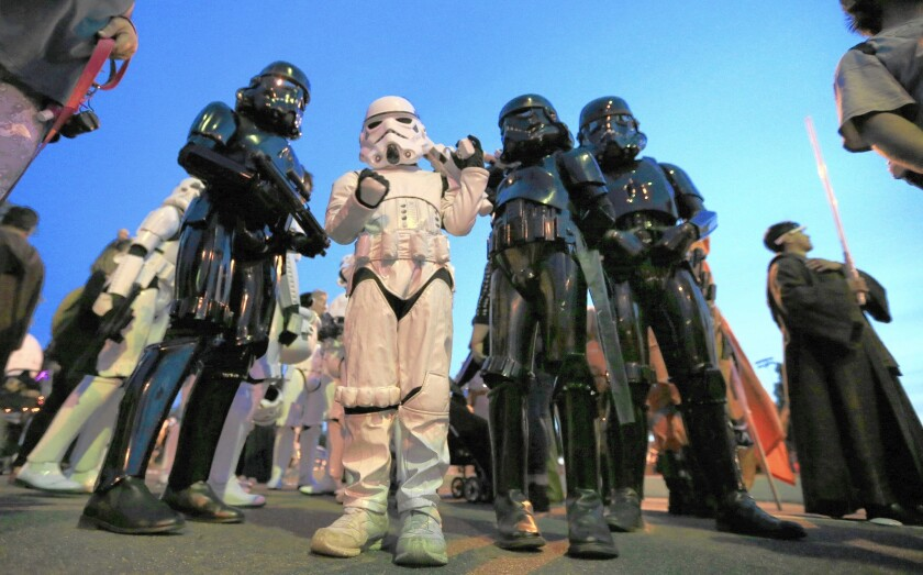 """Members of the Orange County Star Wars Society and Friends of the Mouse Disneyland fan club show off their """"Star Wars"""" costumes during the Anaheim Halloween Parade on Oct. 24, 2015."""