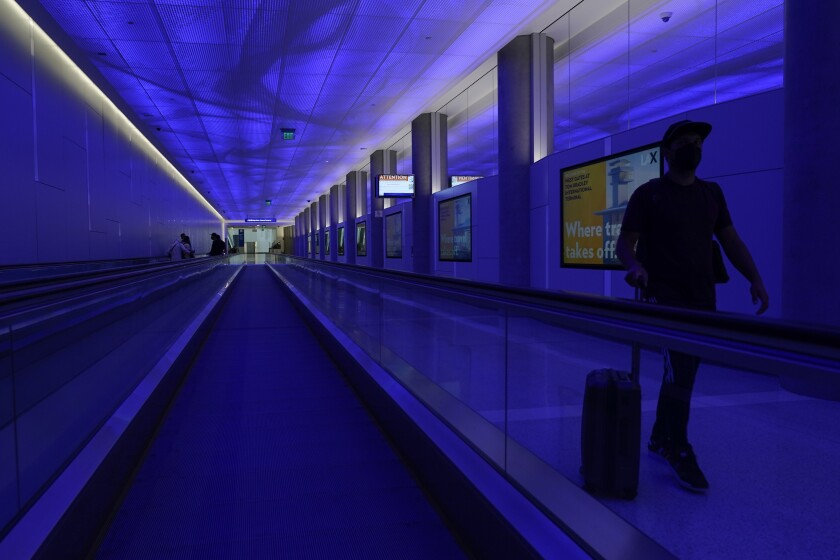 A pedestrian in the passenger tunnel at LAX's West Gates facility