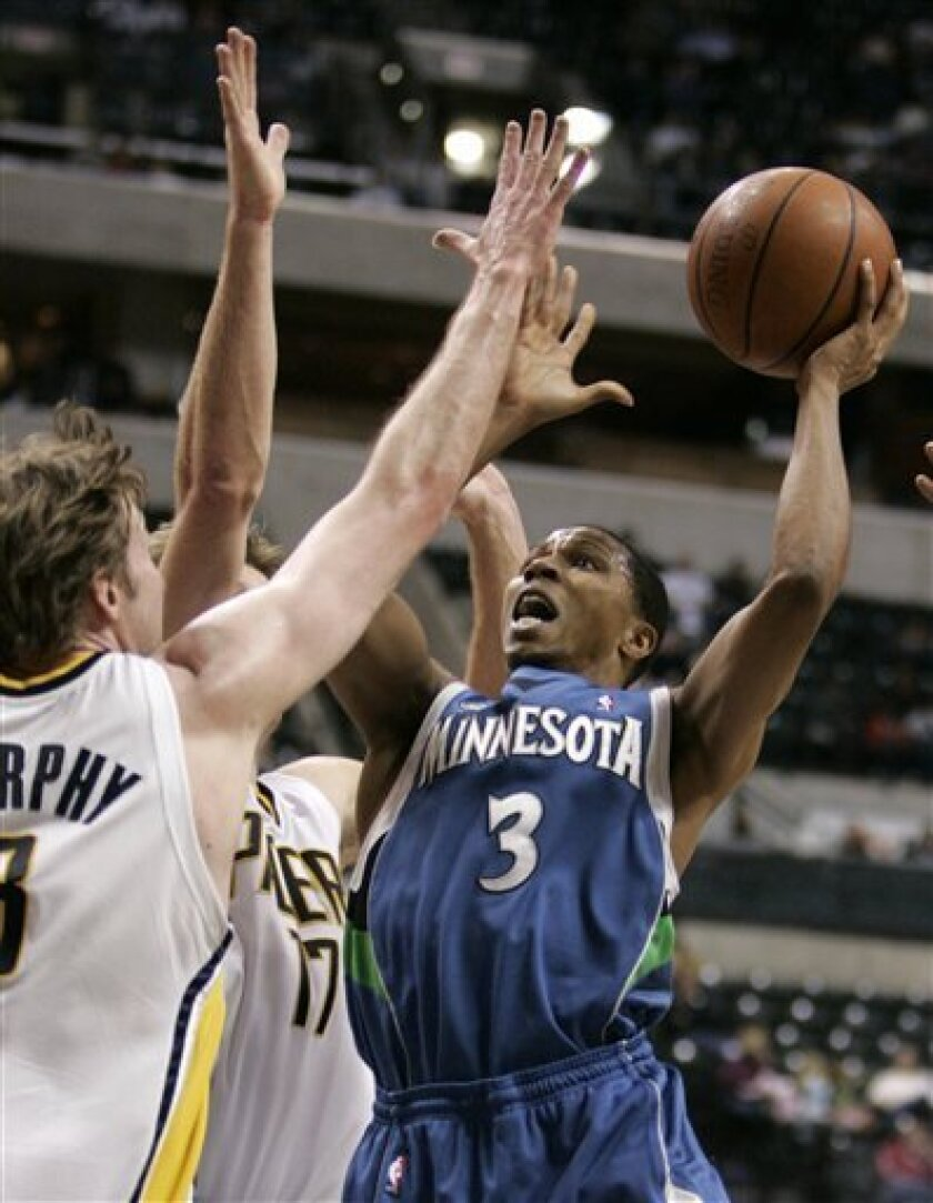 Minnesota Timberwolves guard Sebastian Telfair, right, shoots over Indiana Pacers forwards Troy Murphy, left, and Mike Dunleavy in the second half of an NBA basketball game in Indianapolis, Tuesday, Feb. 3, 2009. The Timberwolves defeated the Pacers 116-111. (AP Photo/Michael Conroy)