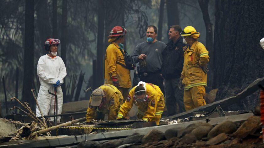 PARADISE, CALIFORNIA--NOV.13, 2018--A forensic team investigates the site of a home where remains we