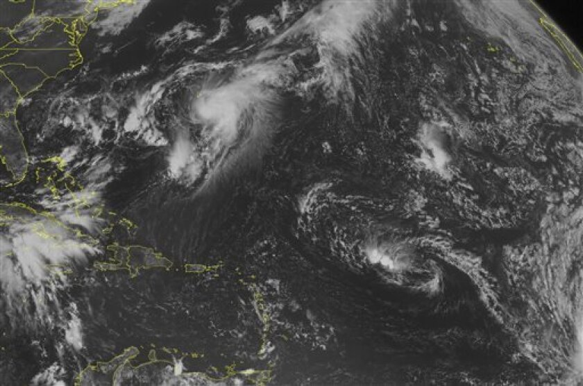 This NOAA satellite image taken Tuesday, September 10, 2013 at 10:45 AM EDT shows Tropical Storm Gabrielle moving south of Bermuda moving northward bringing heavy rain and strong winds to the island. A tropical disturbance over the Bay of Campeche brings rain showers and thunderstorms.(AP PHOTO/WEATHER UNDERGROUND)