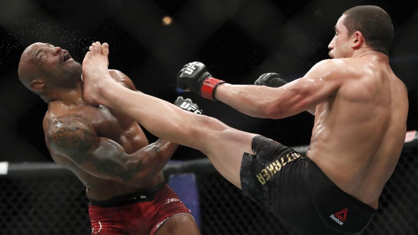 Robert Whittaker, right, defeated Yoel Romero on June 10, 2018, in Chicago. Whittaker, who hasn't fought since, returns Saturday to face Israel Adesanya at UFC 243 in Melbourne, Australia.