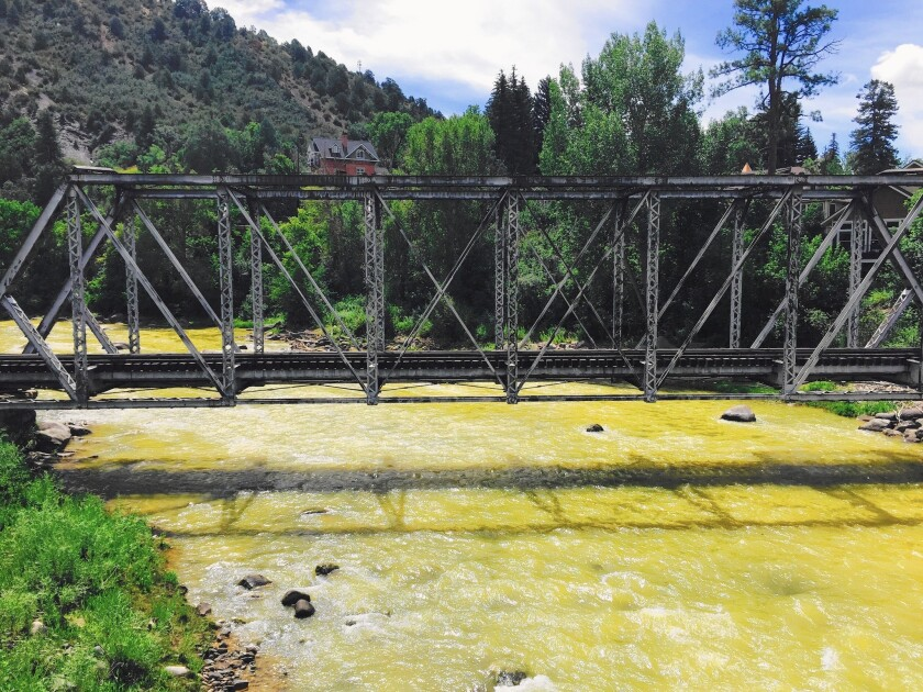 Contaminated water from an old gold mine flows through the Animas River in Durango, Colo. The Environmental Protection Agency initially estimated the spill at 3 million gallons.