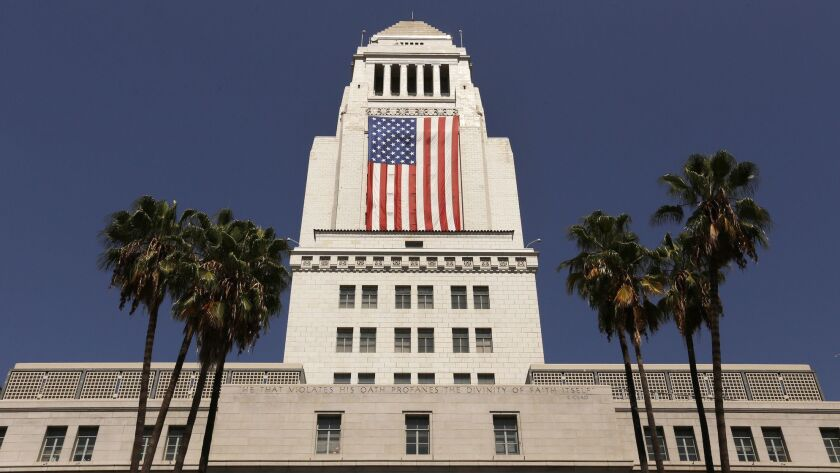 The United States flag is draped on Los Angeles City Hall on Sept. 8, 2017.