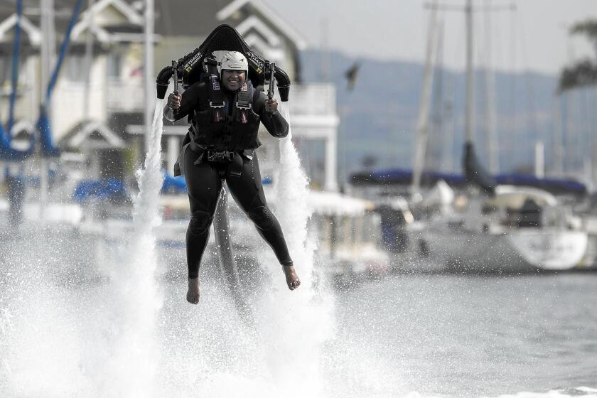 Gracie Henley launches on a water jetpack at Newport Harbor in February 2015.