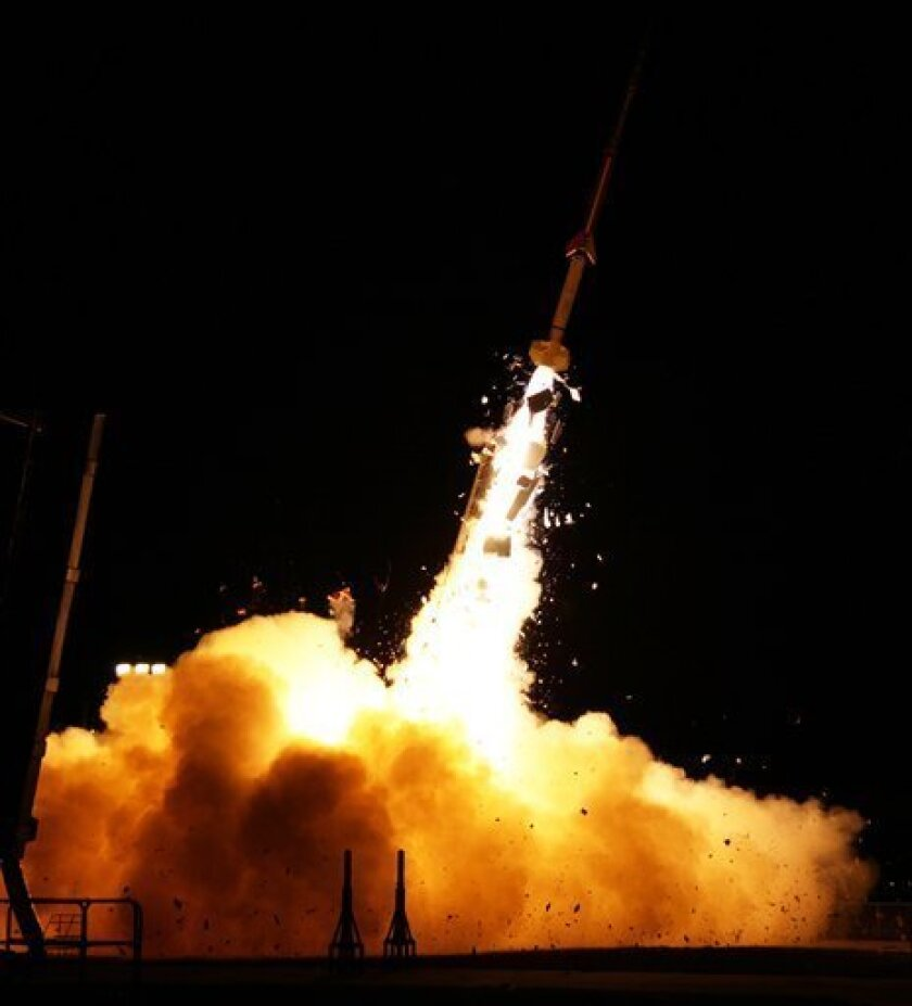 In this photo provided by NASA, a sounding rocket launches from NASA's Wallops Flight Facility in Wallops Island, Va., Tuesday, March 27, 2012, as part of the Anomalous Transport Rocket Experiment (ATREX). Five rockets were launched from the site before dawn Tuesday for the ATREX mission to help scientists understand the upper level jet stream, which is located 60 to 65 miles above Earth's surface. (AP Photo/NASA)
