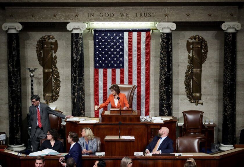 AFP-Getty_House Votes To Formalize Impeachment Inquiry.JPG
