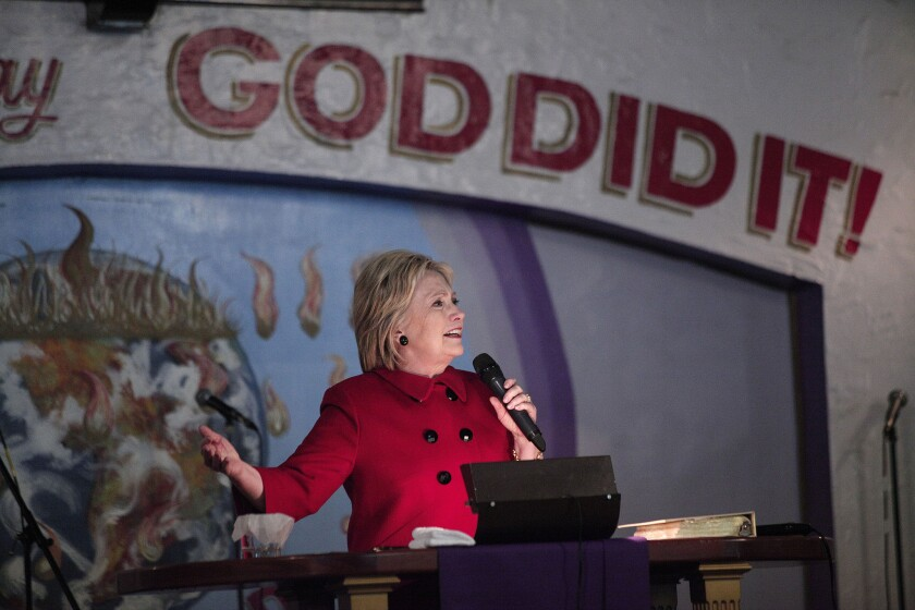 Democratic presidential candidate Hillary Clinton speaks at the Holy Ghost Cathedral in Detroit. Clinton visited three predominantly black churches on Sunday.