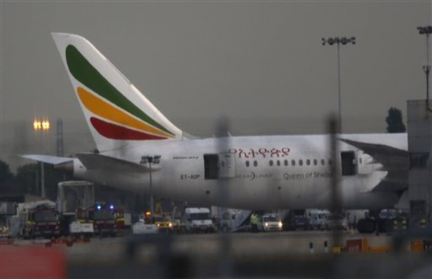 General view of the Air Ethiopian Boeing 787 Dreamliner 'Queen of Sheba' aeroplane, on the runway near Terminal 3, at Heathrow Airport, London, Friday July 12, 2013. Two Boeing 787 Dreamliner planes ran into trouble in England on Friday, with a fire on one temporarily shutting down Heathrow Airport and an unspecified technical issue forcing another to turn back to Manchester Airport. The incidents are unwelcome news for Chicago-based Boeing Co., whose Dreamliners were cleared to fly again in Ap