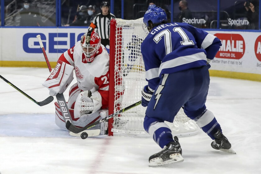 Detroit Red Wings goaltender Thomas Greiss, of Germany, makes a save against Tampa Bay Lightning's Anthony Cirelli during the second period of an NHL hockey game Sunday, April 4, 2021, in Tampa, Fla. (AP Photo/Mike Carlson)