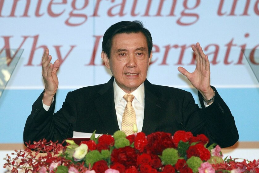 Taiwan's President Ma Ying-jeou speaks as he announces his South China Sea Peace Initiative during the 2015 ILA-ASIL Asia Pacific Research Forum in Taipei, Taiwan, Tuesday, May 26, 2015. President Ma laid out a plan Tuesday to ease tensions in a vast, resource-rich Asian ocean where China has chafed against its neighbors by expanding islets with landfill to solidify its claims in the region.(AP Photo/Wally Santana)