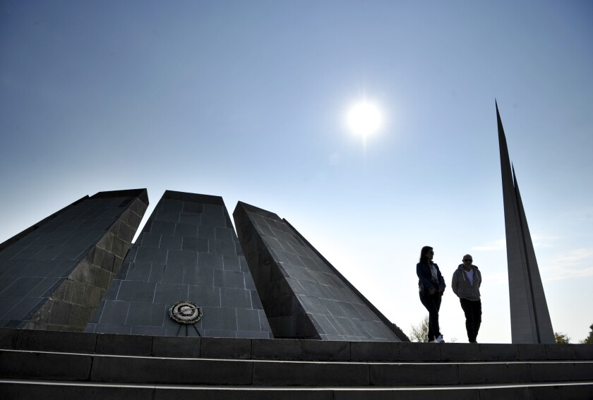 A couple at a memorial to victims of mass killings of Armenians by Ottoman Turks
