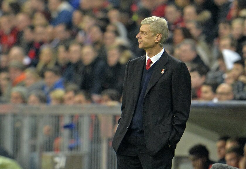 Arsenal manager Arsene Wenger watches from his coaching zone disappointed during the Champions League Group F soccer match between Bayern Munich and Arsenal FC in Munich, southern Germany, Wednesday, Nov. 4, 2015. (AP Photo/Kerstin Joensson)