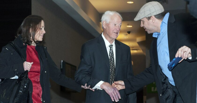Hockey legend Gordie Howe speaks with a fan as he leaves his hotel Friday, Feb. 6, 2015 in Saskatoon, Saskatchewan. The 86-year-old Howe attended a celebrity dinner despite two disabling strokes late last year. His family says his health has improved after stem cell treatment as part of a clinical