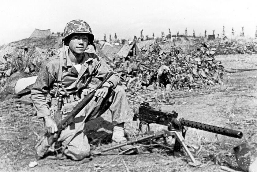 """Lt. Kurt Chew-Een Lee with machine gun, as seen in the """"Uncommon Courage"""" documentary."""