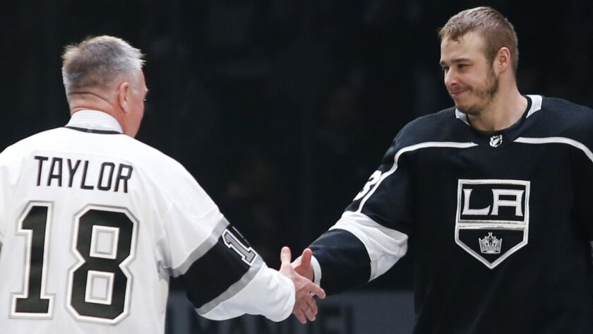 Los Angeles Kings forward Dustin Brown (23) shakes hands with Hockey Hall of Fame Dave Taylor prior