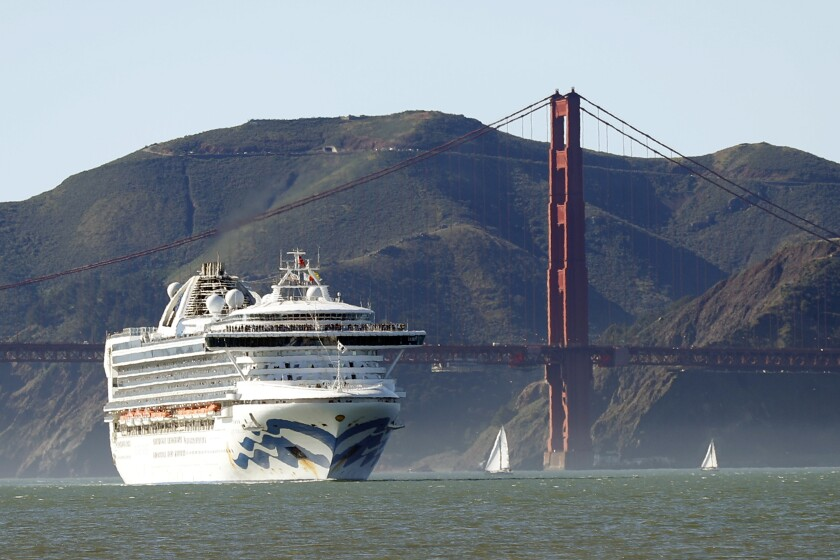 FILE - In this Feb. 11, 2020, file photo, the Grand Princess cruise ship passes the Golden Gate Bridge as it arrives from Hawaii in San Francisco. Scrambling to keep the coronavirus at bay, officials ordered the cruise ship to hold off the California coast Thursday, March 5, to await testing of those aboard, after a passenger on an earlier voyage died and at least one other became infected. (Scott Strazzante/San Francisco Chronicle via AP, File)