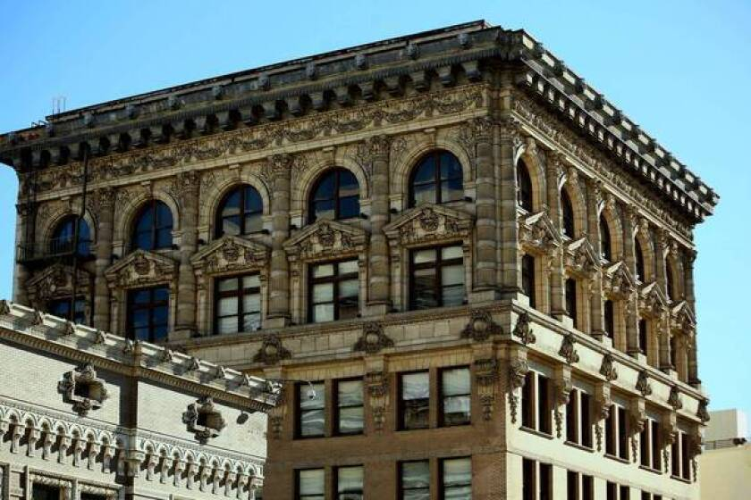 This detail of the Braly Block Building, 1904, shows John Parkinson's attention to decoration as well as structure.