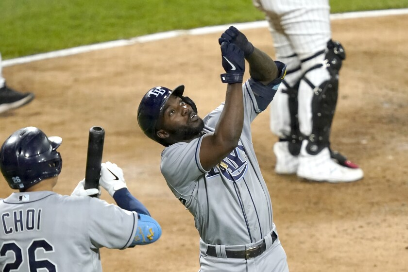 Tampa Bay Rays' Randy Arozarena, right, celebrates his home run off Chicago White Sox relief pitcher Garrett Crochet with Ji-Man Choi during the eighth inning of a baseball game Monday, June 14, 2021, in Chicago. (AP Photo/Charles Rex Arbogast)