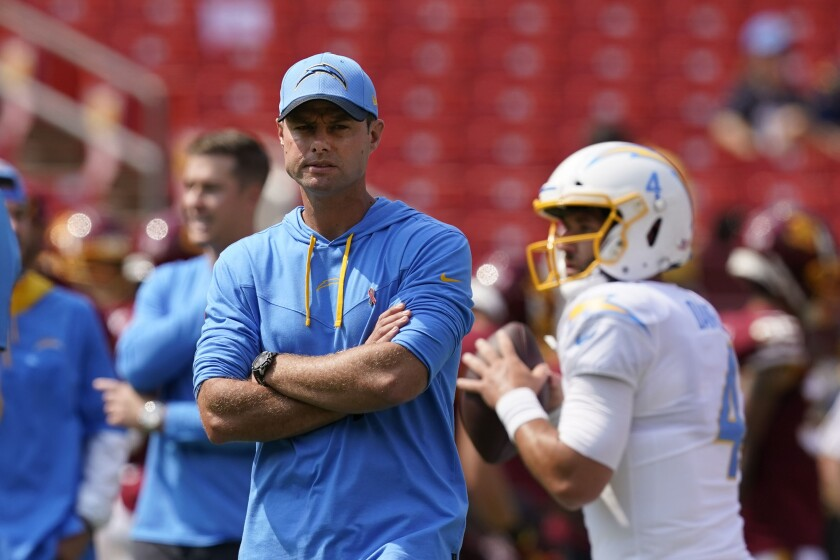 Los Angeles Chargers head coach Brandon Staley walking on the field during pregame warmups prior to the start of the first half of an NFL football game against the Washington Football Team, Sunday, Sept. 12, 2021, in Landover, Md. (AP Photo/Alex Brandon)