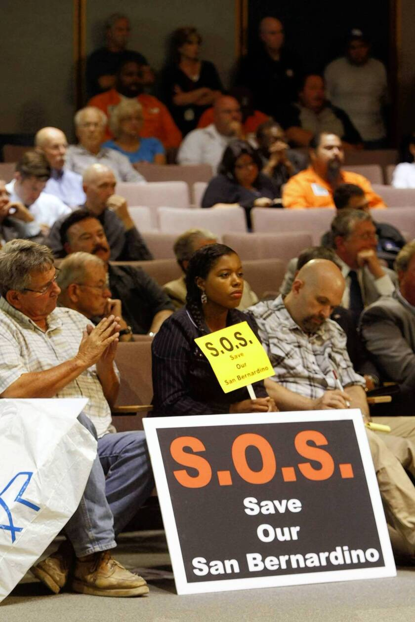 Audience watches the San Bernardino City Council on July 18 declare a fiscal emergency and begin preparations to file for bankruptcy protection.