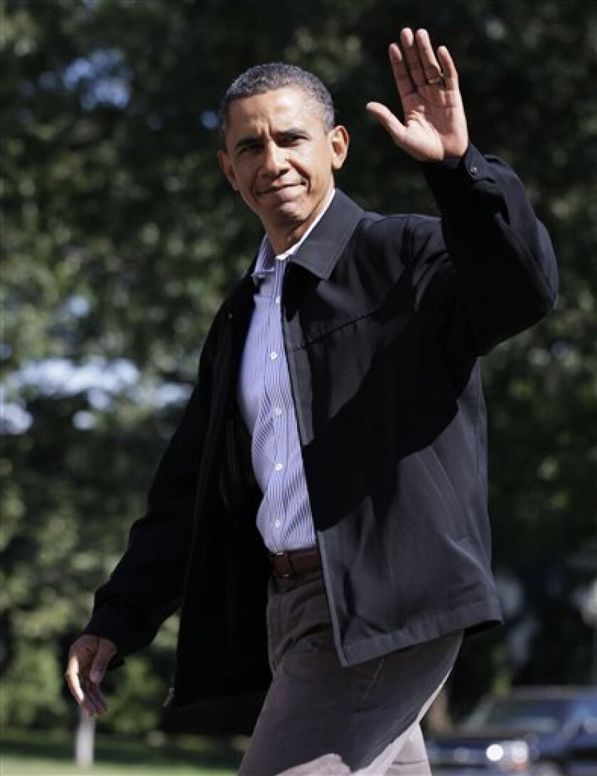 President Barack Obama waves to media as he walks across the South Lawn of the White House after stepping off of Marine One in Washington, Sunday, Sept. 5, 2010. (AP Photo/Carolyn Kaster)