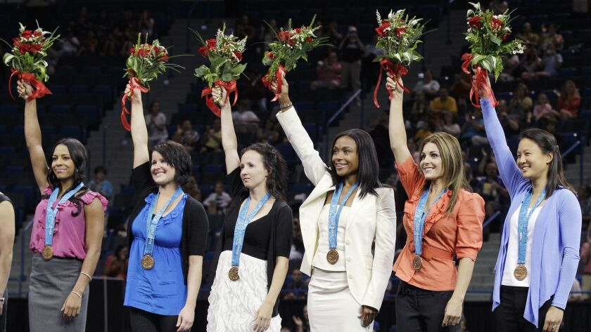 Gymnast Tasha Schwikert, left, and her teammates won the bronze medal at the 2000 Olympics.