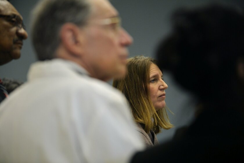 U.S. Department of Health and Human Services Secretary Sylvia M. Burwell listens to questions from the media during a press conference on Thursday, Feb. 18, 2016 at the Hamilton Community Health Network in Flint, Mich. State and federal officials acted to send more help to Flint to deal with its le