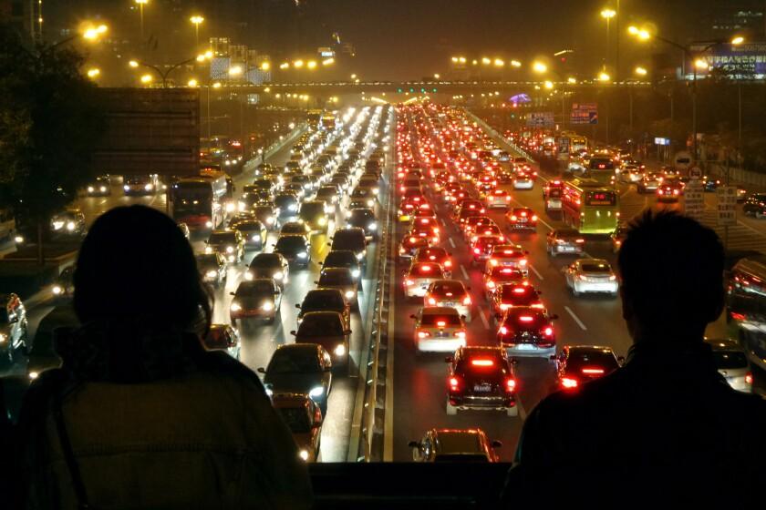 Traffic in Beijing. Plenty of drivers, plenty of riders.