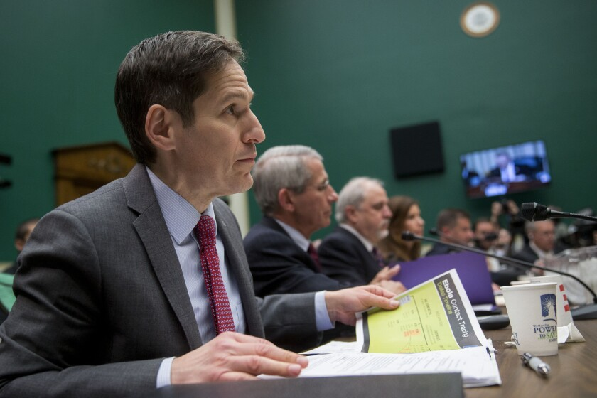 Thomas Frieden, director of the Centers for Disease Control and Prevention (CDC), left, listens during a House Energy and Commerce Committee subcommittee hearing Thursday.