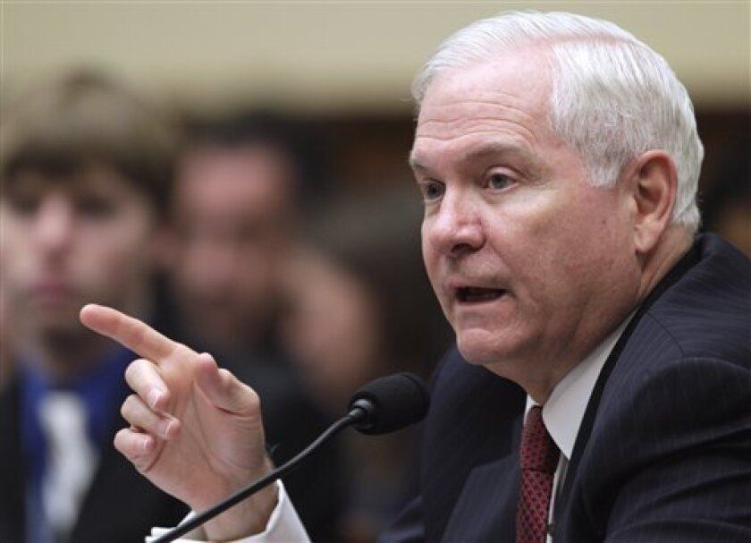 Defense Secretary Robert Gates testifies on Capitol Hill in Washington, Thursday, March 31, 2011, before the House Armed Services Committee hearing on military operations in Libya. (AP Photo/Carolyn Kaster)