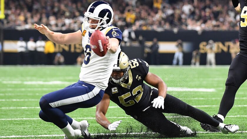 NEW ORLEANS, LOUISIANA, NOVEMBER 4, 2018-Rams place holder Johnny Hekker can't make the 1st down on