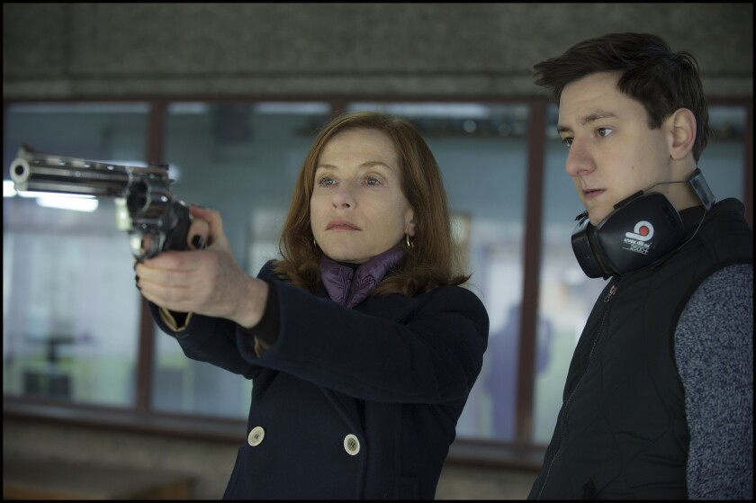 """Isabelle Huppert as Michèle Leblanc and Arthur Mazet as Kevin in """"Elle."""""""