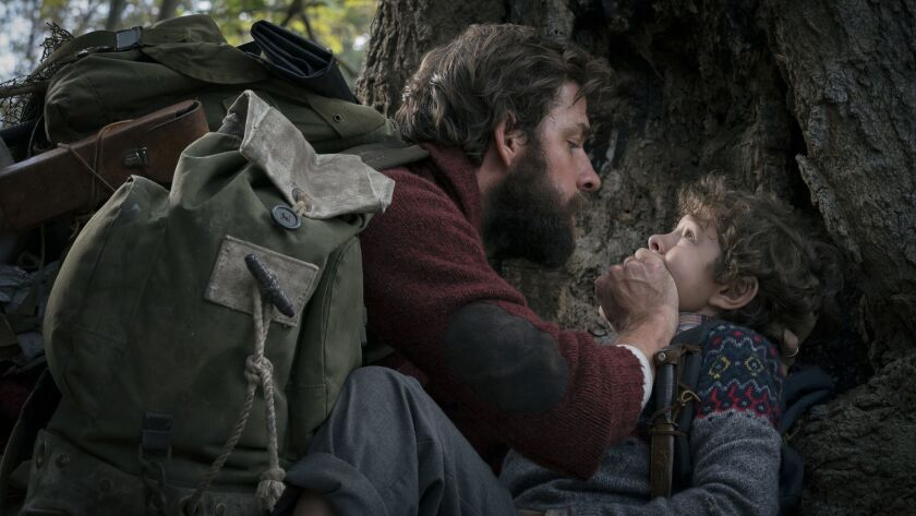 This image released by Paramount Pictures shows John Krasinski, left, and Noah Jupe in a scene from