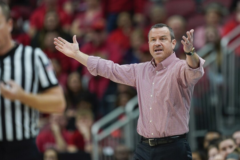 Louisville head coach Jeff Walz reacts to a play during the second half of an NCAA college basketball game against Virginia Tech, Sunday, March 1, 2020, at the KFC YUM Center in Louisville, Ky. (AP Photo/Bryan Woolston)