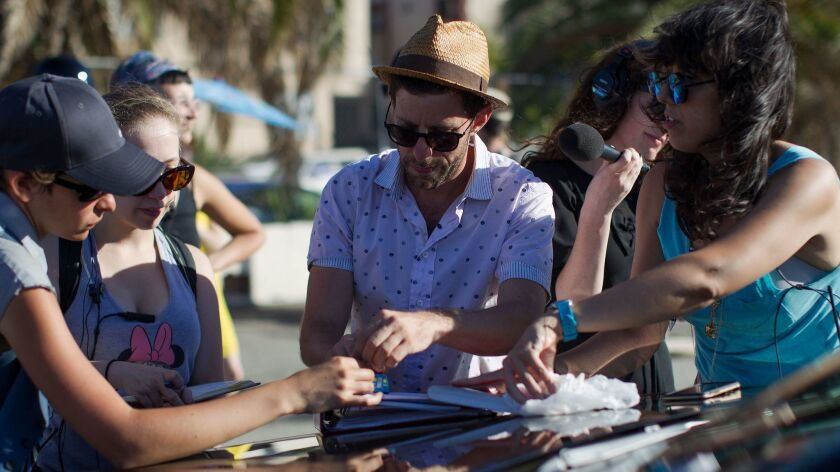 LOS ANGELES, CA - OCTOBER 1, 2015: Artistic director Yuval Sharon, middle, works with his crew durin