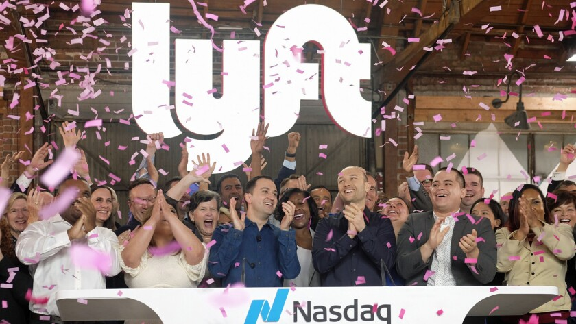 Lyft co-founders John Zimmer, center left, and Logan Green, center right, at Lyft's IPO event in Los Angeles.