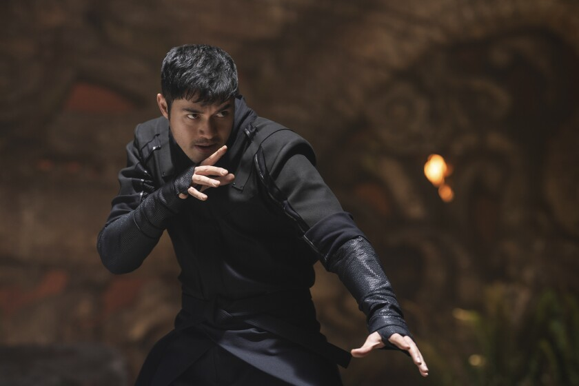 Henry Golding gets ready to fight