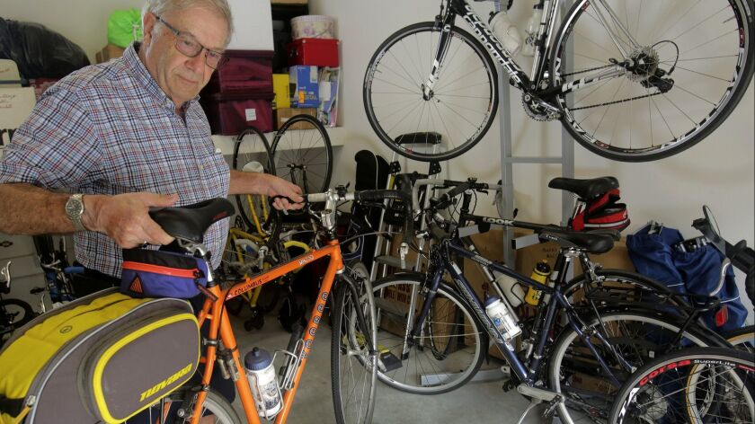 Dr. Daniel Marks picks up one of the more rugged bicycles in his collection of bikes at his Carlsba