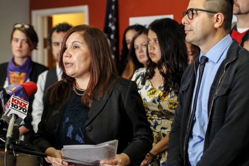 Executive Director Angelica Salas addresses a news conference held by the Coalition for Humane Immig