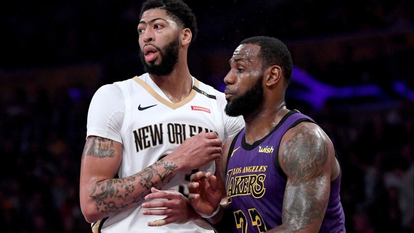 Lakers' LeBron James and New Orleans Pelicans' Anthony Davis defend each other during a 112-104 Laker win at Staples Center on Friday.