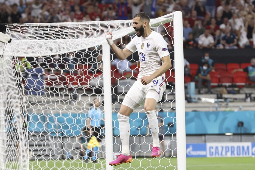 France's Karim Benzema celebrates after scoring his side's first goal during the Euro 2020 soccer championship group F match between Portugal and France at the Puskas Arena in Budapest, Wednesday, June 23, 2021. (Bernadett Szabo, Pool photo via AP)