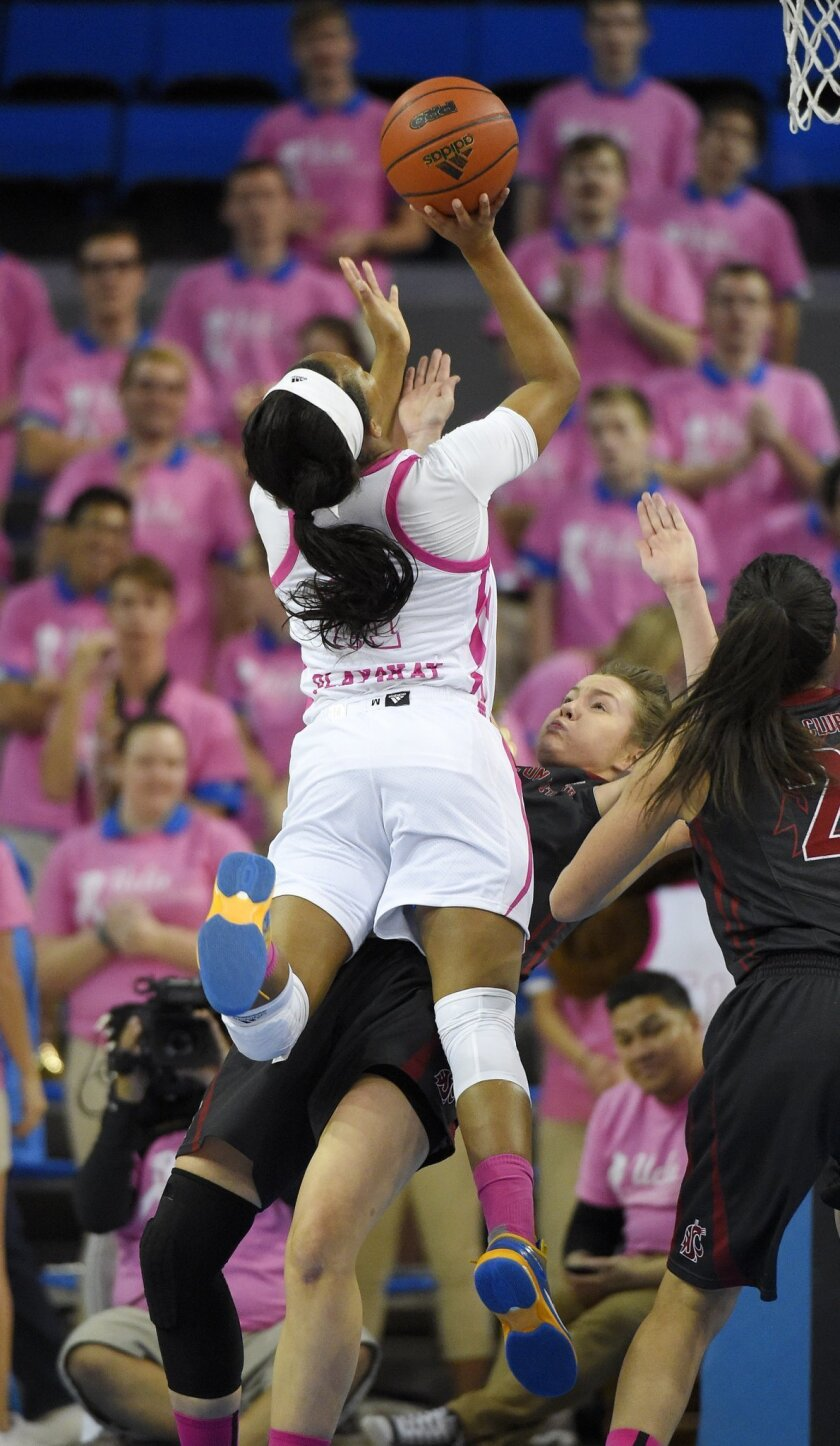 UCLA forward Lajahna Drummer, left, shoots as Washington State forward Louise Brown defends during the first half of an NCAA college basketball game Friday, Feb. 12, 2016, in Los Angeles. (AP Photo/Mark J. Terrill)
