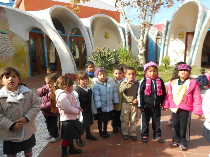 Students front the Colegio La Esperanza Elementary in Tijuana, Mexico.
