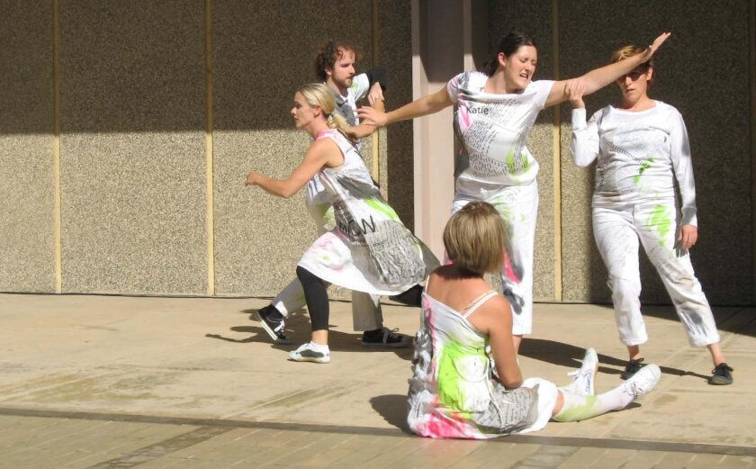 """Members of the Wallpaper Performance Company perform improvisational steps in """"Pause (for world creation)"""" at the La Jolla Playhouse's Without Walls Festival on the UC San Diego campus."""