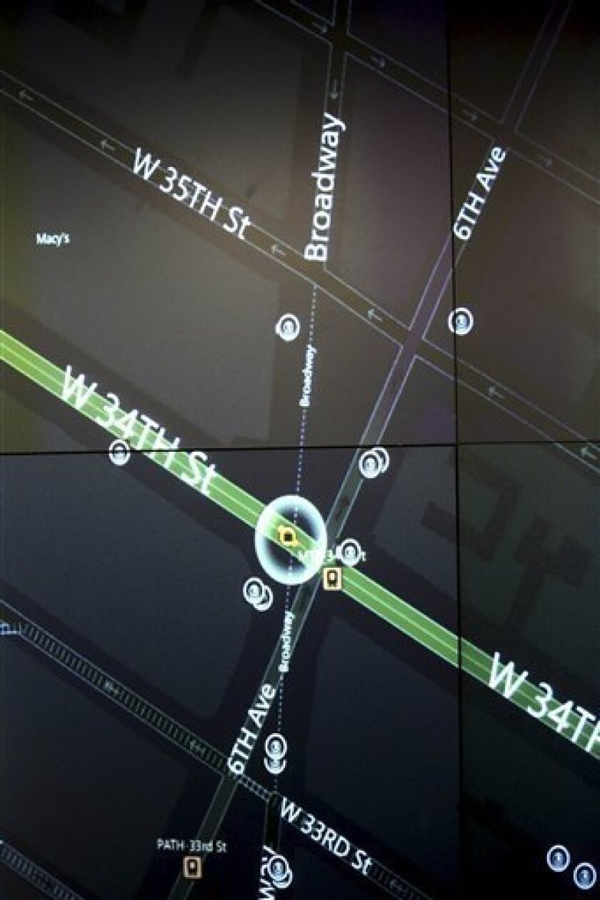 This Tuesday, Feb. 19, 2013 photo shows a detail of a video wall showing New York city police officers an interactive map of an area in the city, security footage from nearby cameras, if there are high radiation levels and whether any other threats have been made in New York. The Domain Awareness S