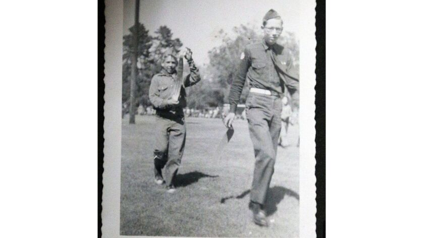 ElRey Ensch, in front in this 1955 image in a picture album, at the Boy Scout Troop 501 meeting room